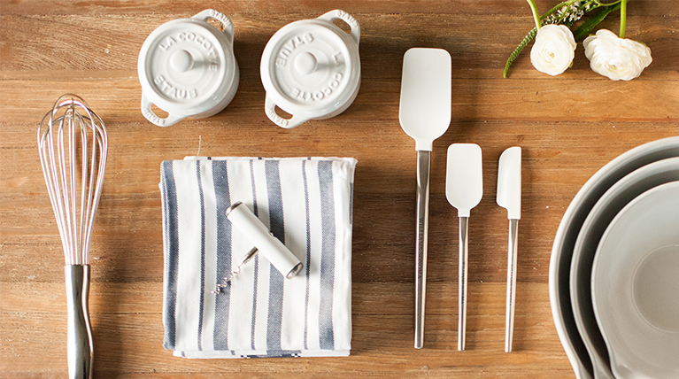 white kitchen utensils on butcher block table top