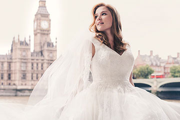 Bride in Jewel Wedding Dress with Lace Applique with Parliament behind her