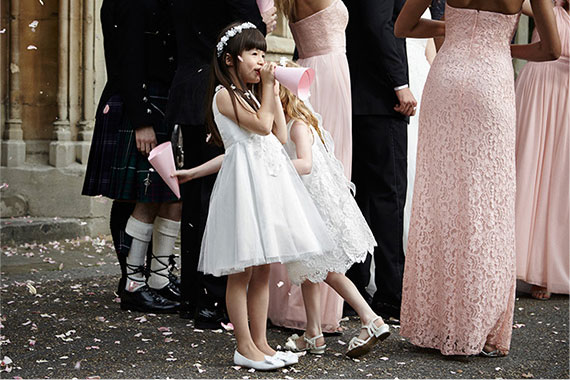 Flower Girl using seed paper cone as a horn