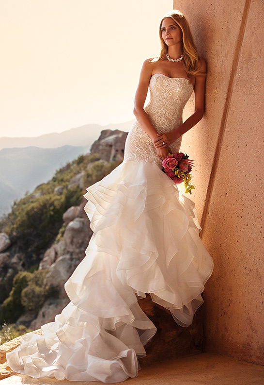 Bride in beaded lace mermaid dress with ruffle train