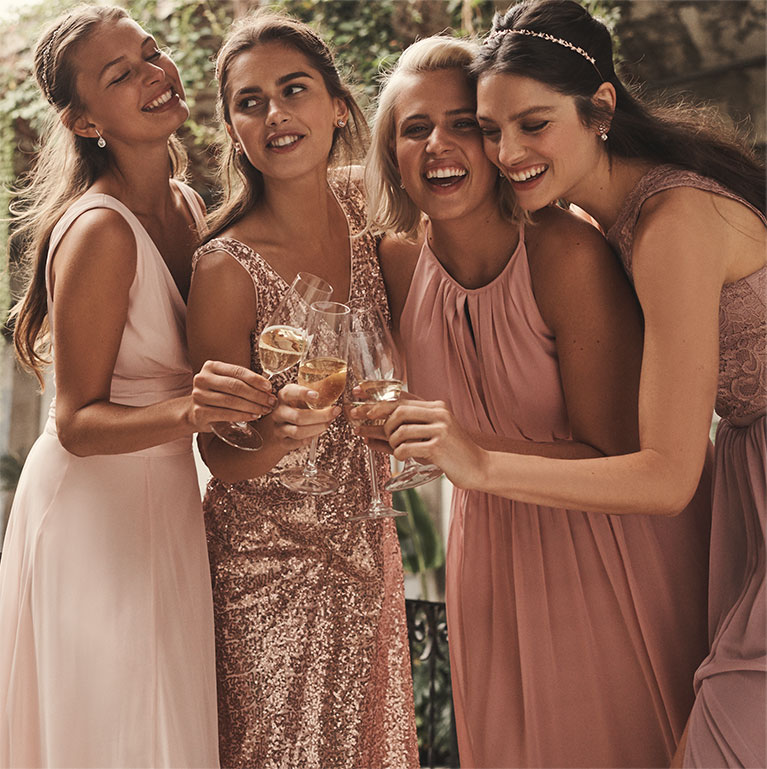 bridesmaids laughing and celebrating