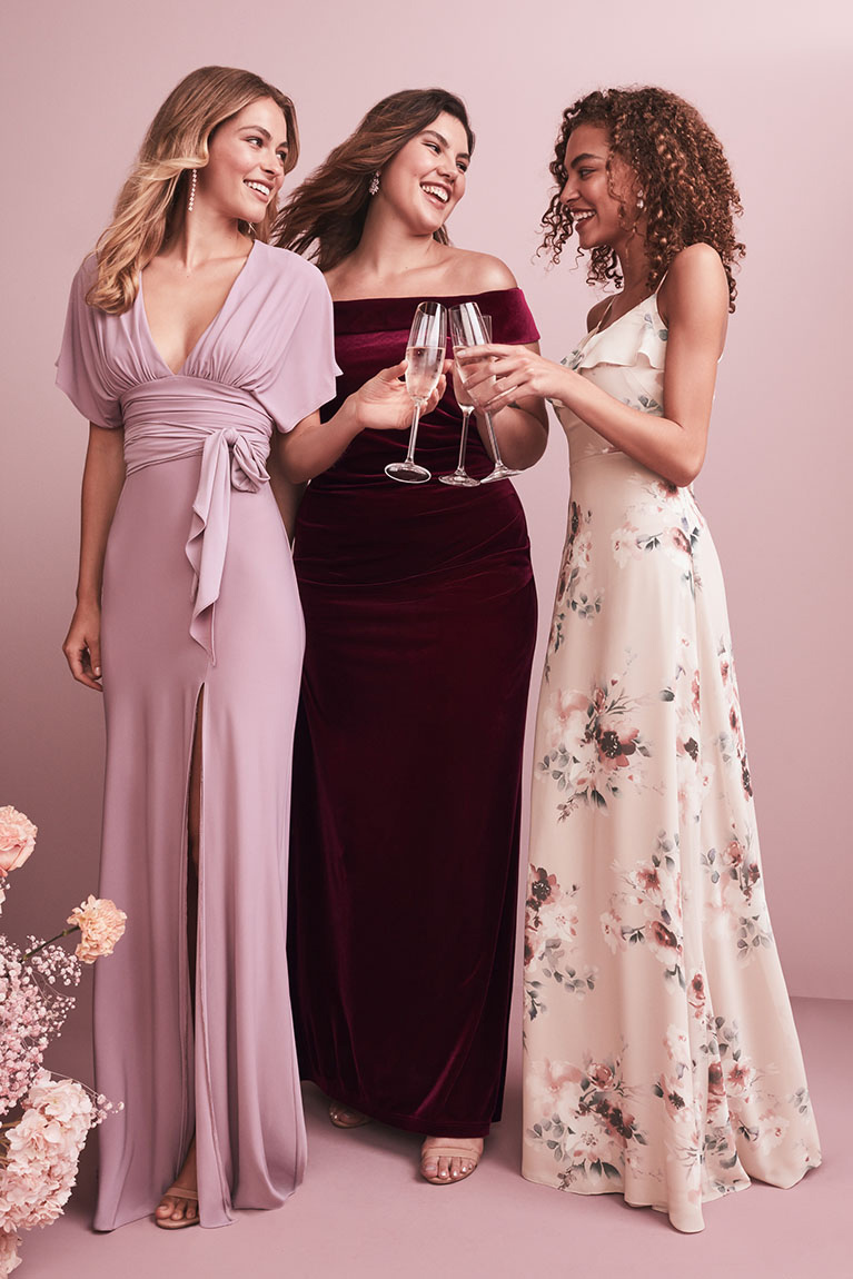 Bridesmaids in mis-matched v-neck purple and wine bridesmaid dresses