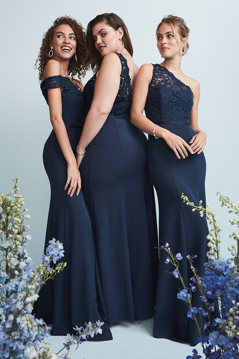 Bridesmaids posing while wearing bridesmaid dresses