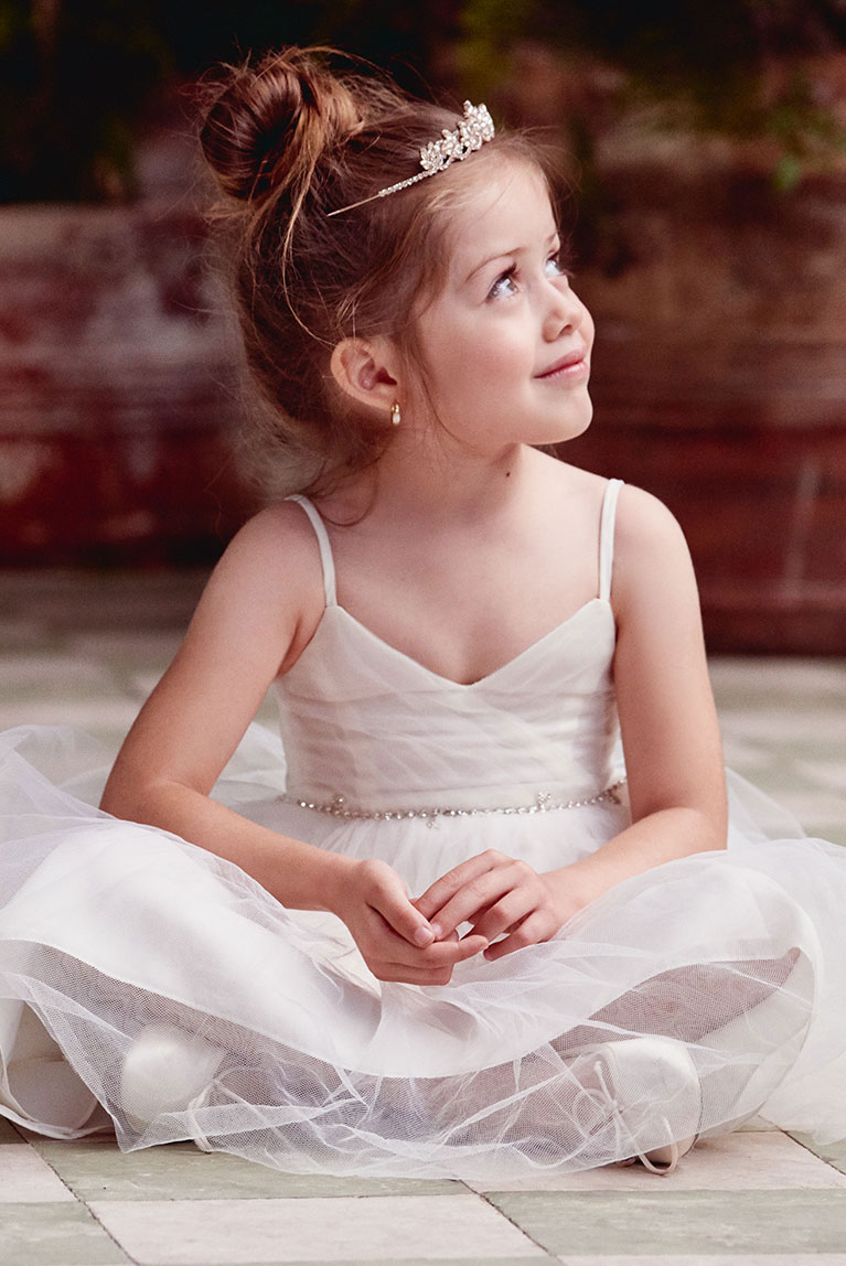 Flower Girl wearing tiara and matching earrings