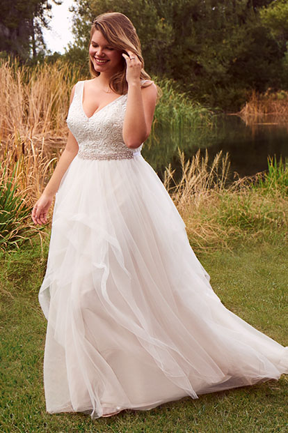 Bride in a v-neck plus size wedding dress.