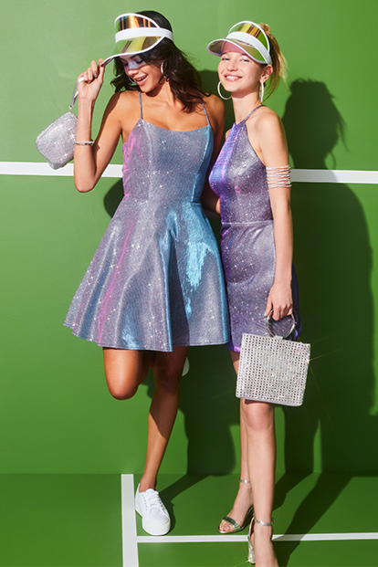 two girls wearing short homecoming dresses.