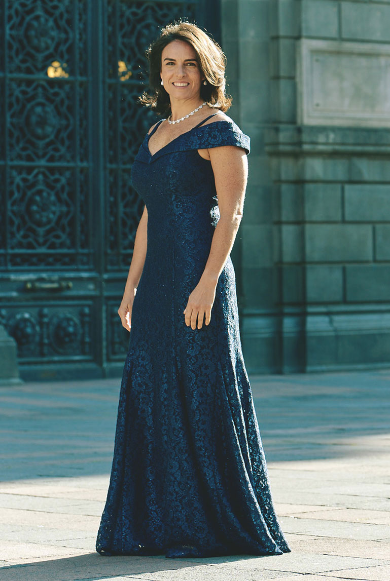 Mother of the bride wearing a long, off the shoulder formal dress
