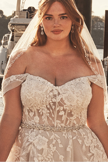 Bride wearing off the shoulder gown with crystal belt.