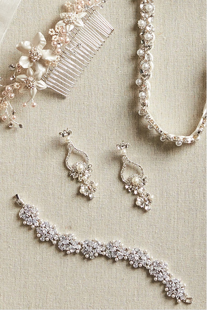 Bracelet, hair clip, and earrings from David's Bridal.