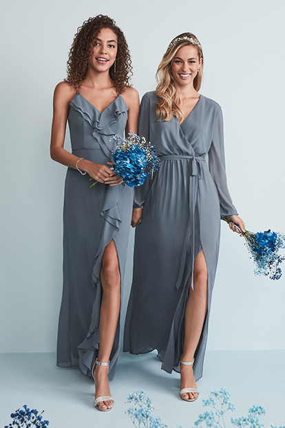 Two bridesmaids wearing ready-to-ship dresses.