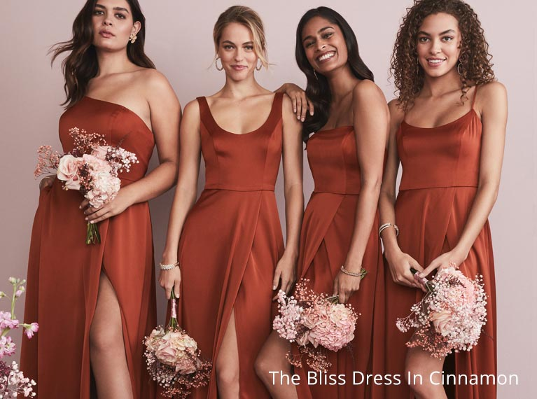 Four bridesmaids wearing cinnamon color dresses.