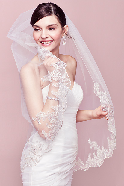 Smiling Bride Wrapped In Veil