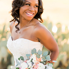 Bride Smiling Back with Bouquet