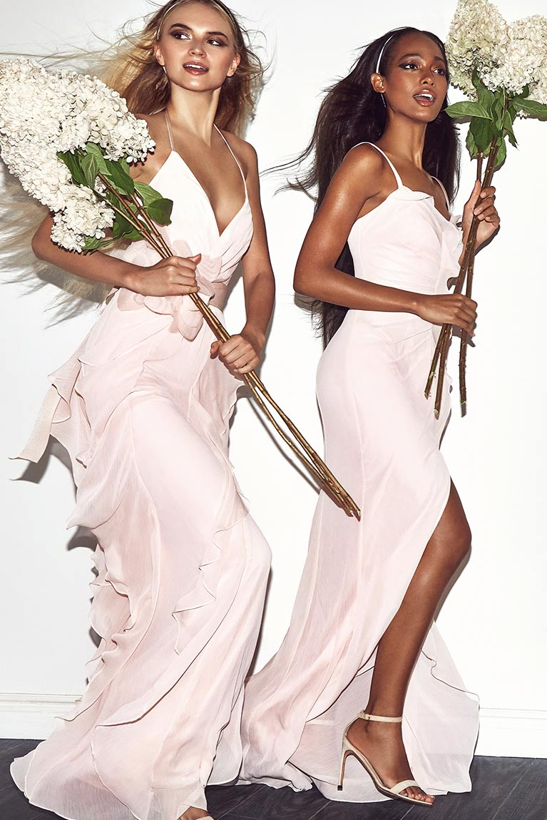 Bridesmaids in Pink Dresses Holding Large Flowers