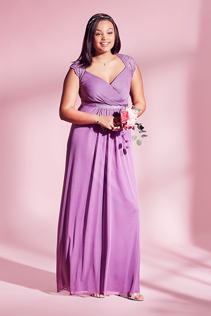 Plus Size Bridesmaid in Purple Dress with Bouquet