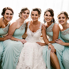 Blue Bridal Party Sitting Down with Bride