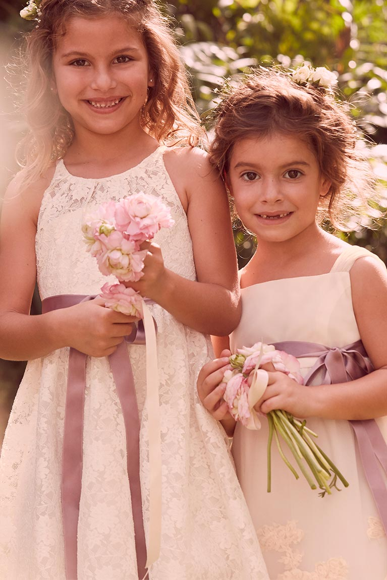 Dress styles inspiration tips trends 2017 davids bridal two smiling flower girls holding flowers and wearing flower crowns ombrellifo Images