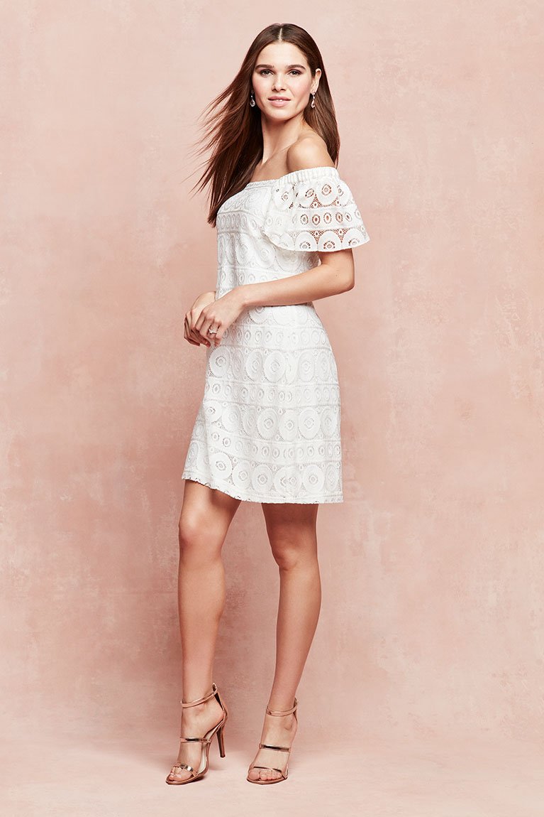 Flirty little white off-the-shoulder dress with strappy metallic heels />         </a>         <div class=