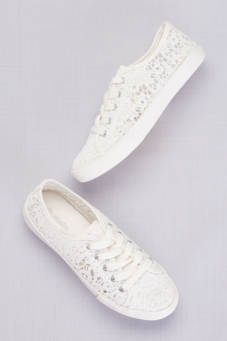 Pair of white lace sneakers