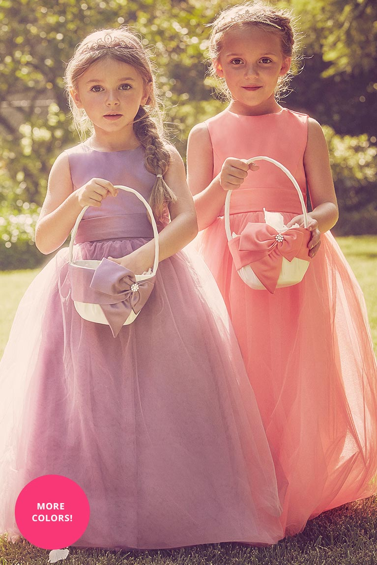 Flower girls in pink and purple dresses with matching baskets