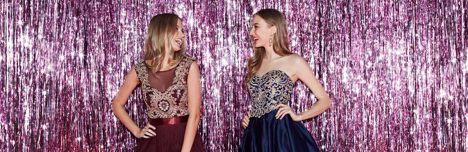 Two girls wearing Homecoming dresses at their dance.