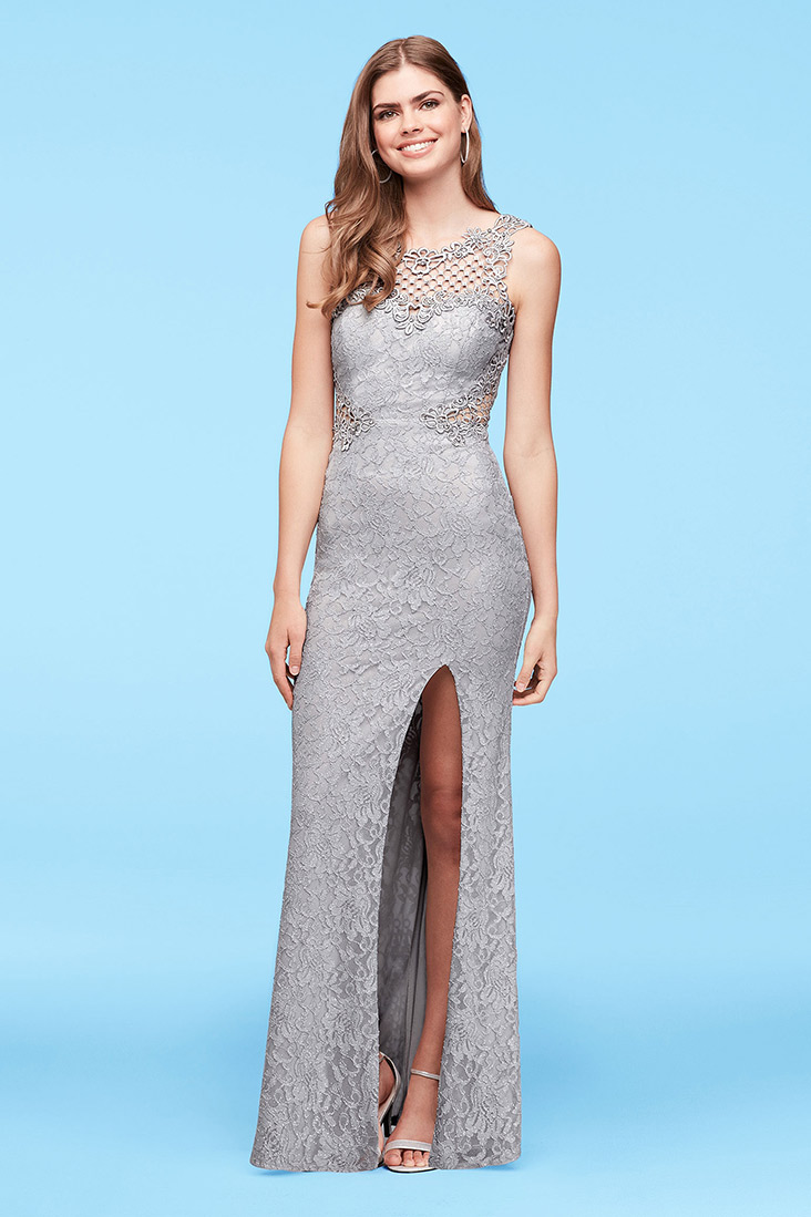 Model smiling in silver formal dress with slit
