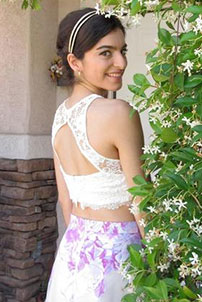 Prom girl in two piece floral skirt and cut out back top