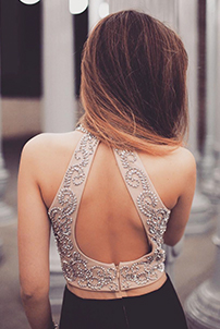 Back shot of real prom girl in two-piece gold embellished and black dress