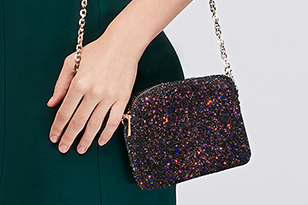 Close up of prom girl holding colorful clutch