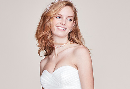 bride smiling in white dress and necklace