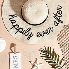 wide brimmed hat that says happily ever after
