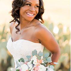 Bride smiling while holding her bouquet
