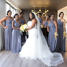 Grey bridal party around bride