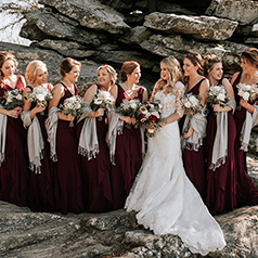 Red bridal party with shaws