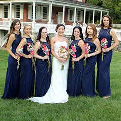 Blue bridal party with pink flowers