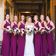 Purple bridal party around bride