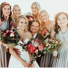 Group picture of bride and groom with bridesmaids