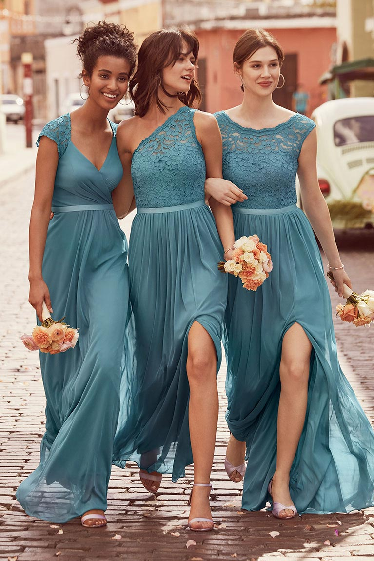 Bridesmaids inspiration exclusive styles trending looks three bridesmaids in teal blue dresses linking arms down street ombrellifo Image collections