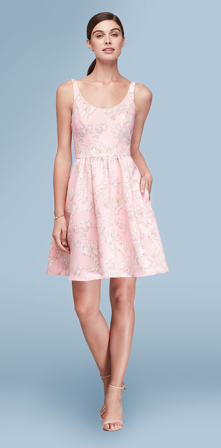 Wedding guest in short like pink occasion dress