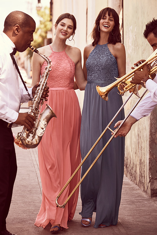 Bridesmaids with jazz musicians in the street