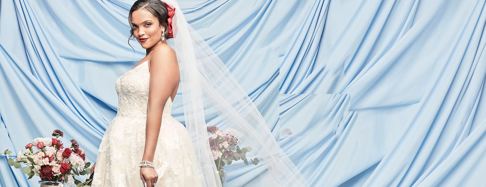 bride wearing strapless oleg cassini wedding gown.