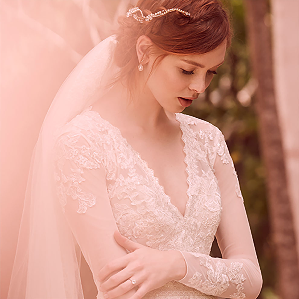 Portrait of bride gazing down at ground