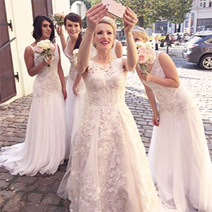 Bride taking selfie with bridesmaids