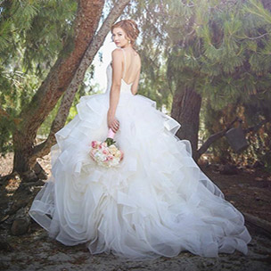 Bride in strapless wedding dress with tulle and long train