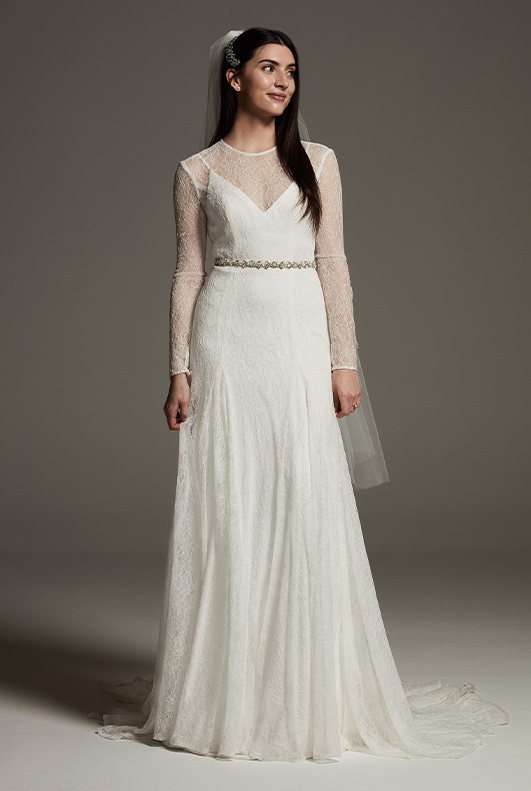 bride wearing long sleeve lace white by vera wedding dress