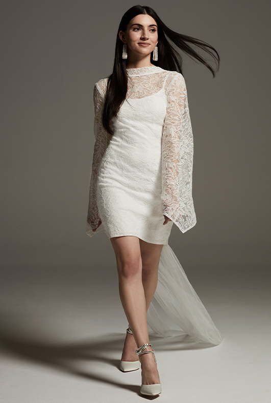 bride wearing lace long sleeve, short white by vera wang wedding dress