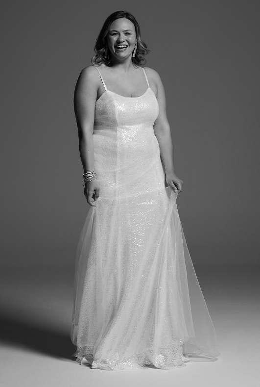 bride wearing spaghetti strap white by vera wang wedding dress