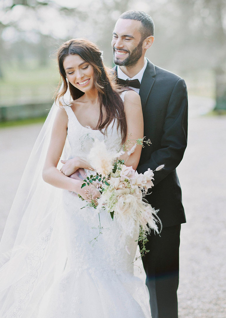 Truly zac posen wedding dress collection davids bridal bride hold flowers and posing outside with her groom ombrellifo Image collections