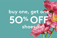 green banner with flowers advertising buy one, get one 50% off shoes