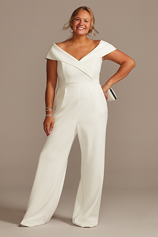 Bride wearing a wedding jumpsuit.